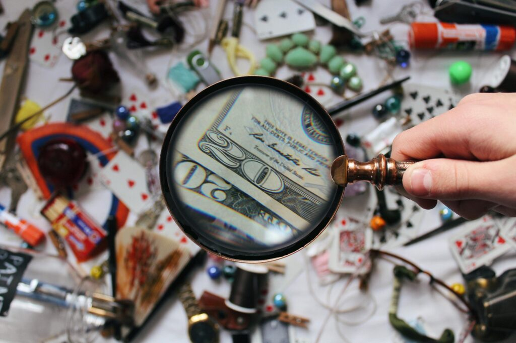 magnifying glass looking over a messy table