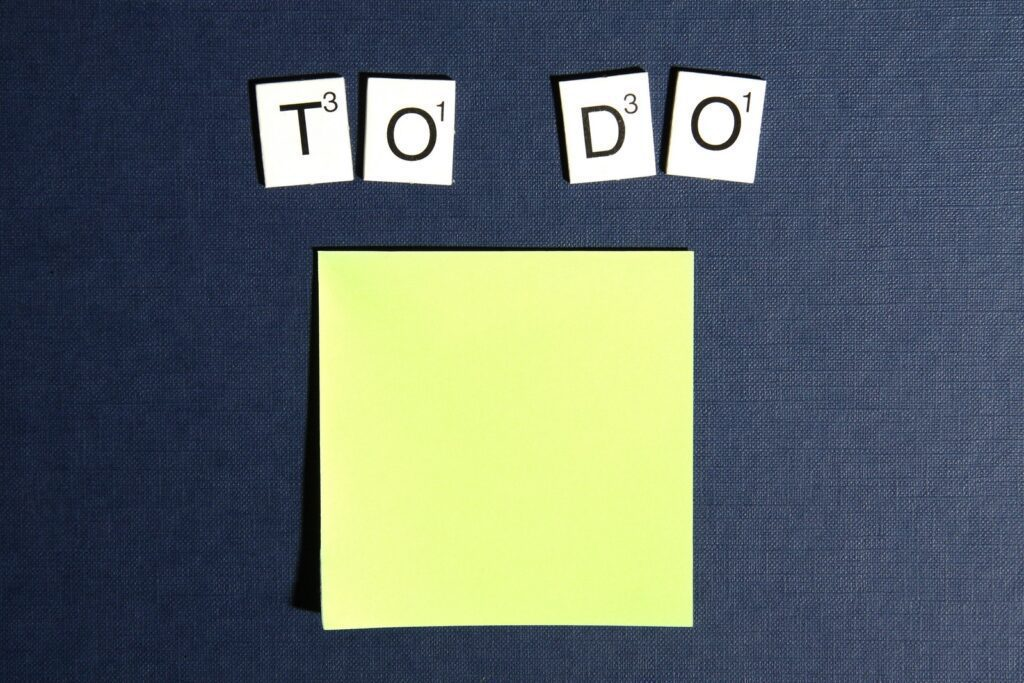 "yellow post it with scrabble ""to do"" spelled out"